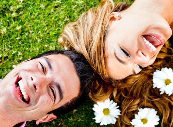 Happy couple having fun and smiling outdoors